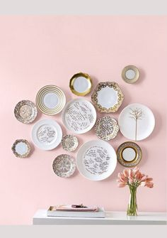 This lovely wall piece is a fabulous way to showcase mismatched china and remember all the beautiful people that spent your special day with you. Image by bespoke-bride.com