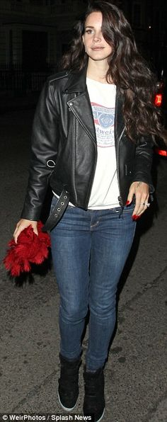 The mane attraction: Lana Del Rey shows off her cascading Hollywood style curls…