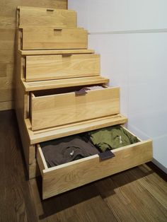 Steps leading to a sleeping loft double as drawers for clothes.