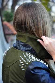 spike details. khaki / leather jacket.