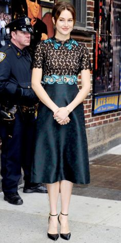 For her appearance on the Late Show with David Letterman, Shailene Woodley played with a more ladylike silhouette with a Mary Katrantzou design that boasted a paisley lace embroidered bodice and an A-line skirt of modest length. Black ankle-strap pumps served as her shoe of choice.