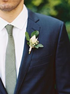 Love this greenery wedding boutonniere! With beautiful navy navy suit. #greenerywedding Wedding Ideas By Colour: Sage Green Wedding Theme - And the bride wore... | CHWV