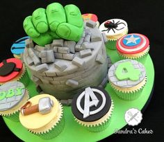 Cake with RKT Hulk fist bursting out of it, surrounded by Avengers cupcakes