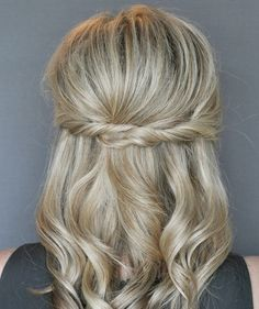 This easy twist hairstyle takes no more than five minutes to achieve, yet it is infinitely more special than your standard half-up do.