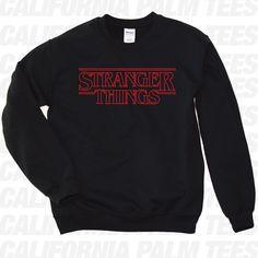 Stranger Things Logo Sweatshirt. Stranger Things Sweatshirt. Stranger... ($20) ❤ liked on Polyvore featuring tops, hoodies, sweatshirts, logo sweatshirts, sports shirts, shirt top, crew top and logo shirts