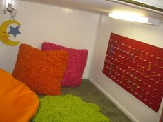 Playrooms: kids playhouse; geoboard wall made from Peg board