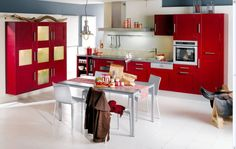 Red Kitchen Cabinet With Silver Pulls And Unique Bulb Pendant Light Above Dining Table Set In Red Kitchen Decoration