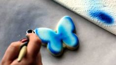 Creating a blue butterfly using airbrushing and hand painting.