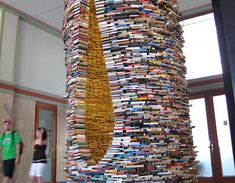 Spellbinding Tower Made From Hundreds of Books - http://inhabitat.com/matej-krens-idiom-is-a-spellbinding-tower-made-from-hundreds-of-books/