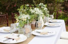 rustic southern wedding tablescape greenery flowers burlap lace mason jars…