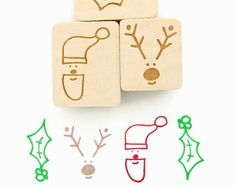 ALL NEW Wood Mounted Rubber Stamp  ▴ DESIGN ▴ Minimal Reindeer  ▴ SIZE ▴ Design is 1.25 (3.5 cm) tall  ▴ DETAILS ▴ This stamp is a hand-drawn design; A