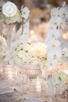 Alternating heights of crystal vases with roses, hydrangea and phalaenopsis orchids, so perfect.