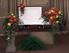 dark mahogany casket with pink spary of flowers | Casket Spray