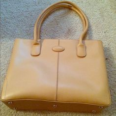 Large brown tote Super cute and would match almost anything! Light brown structured tote. Stands up on its own. Has gold hardware and feet as shown in pix. Has a large pocket in the middle of the bag which separates the purse into two sides. And another small zippered pocket on the inside. Zip closure. Large straps. Great bag!!! Bags Totes