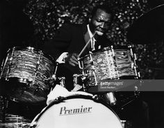http://media.gettyimages.com/photos/elvin-jones-us-jazz-drummer-seated-behind-a-drum-kit-during-a-live-picture-id113573692