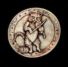 Hobo Nickel by Howard Thomas, Cat and the Fiddle.  Carved on a 1936 Buffalo nickel.  Celestial border.