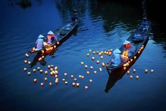 Floating Lights, Vietnam Girls in traditional ao dai dresses in Hue city (central Vietnam) are dropping floating candles on the river to pray for dead people. It's a tradition of Vietnamese people. Vietnam Tour Packages, Vietnam Tours, Vietnam Travel, Floating Lights, Floating Candles, Vietnam Voyage, National Geographic Travel, World Photo, Jolie Photo