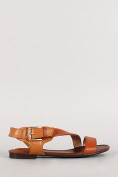 """Breckelle Two Tone Buckle Strappy Open Toe Flat Sandal. Description Featuring an open toe front, strappy construction vamp with buckle accents, stitching details, lightly cushioned insole, and easy slip on style.Material: Leatherette (man-made)Sole: Synthetic  Measurement Heel Height: 0.5"""" Flat (approx)Fitting Tips:Foot Model is a true size 6, foot measures 8.9"""" from heel to toe, width measures 3.25"""".Model's Review: True to size."""