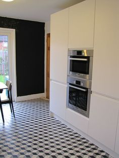 NC224228. Encaustics looking great on a kitchen floor. Encaustic Tiles Brisbane