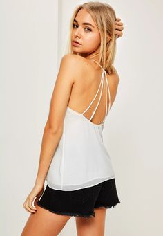 We're bringing sexy back! Pump up your look in this crisp white cami top - featuring a v neck and multi strap back for an edgy finish.