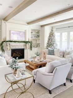 Neutral Christmas Decor Living room decked out for Christmas, with lots of cozy texture and faux greens, with a gorgeous faux flocked tree as the focal point in this beautiful Christmas design. Christmas Living Rooms, Christmas Home, Christmas Design, Nordic Christmas, Christmas Kitchen, Modern Christmas, Simple Christmas, White Christmas, Christmas Ideas
