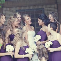 "Chloe's nine bridesmaids and the ""best lady"" wore long chiffon gowns by Liz Fields in a deep purple color."