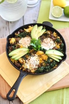 Ground Beef & Butternut Squash Breakfast Skillet 1-2 tbsp lard 450g grassfed ground beef 1 small onion, chopped 2 celery stalks, chopped 3 cloves garlic, minced ½ tsp Himalayan or fine sea salt ¼ tsp ground white pepper 1 tsp ground cumin ½ tsp ground coriander 1 tsp garam masala ½ large butternut squash, cooked 450g spinach, chopped 3 pastured eggs ½ avocado, peeled and sliced