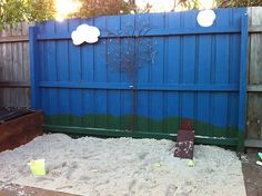 Best Sand Pit Ever!  From www.claireyhewitt.blogspot.com  Claire's adorable sand pit and painted fence.  I WANT this.