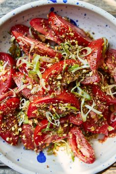 Tomatoes tossed with cumin, pickled jalapeño, scallions, and pistachios