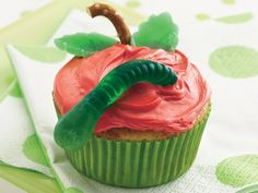 An Apple A day Cupcake: Ingredients: Cupcakes: -1 box Betty Crocker® SuperMoist® yellow cake mix -½ teaspoon ground cinnamon -¾ cup apple juice -⅓ cup unsweetened applesauce -3 eggs Frosting: -½ teaspoon red paste food color -1 container Betty Crocker® Rich & -Creamy vanilla frosting Decorations: -12 thin pretzel sticks, broken into pieces -16 spearmint leaf gumdrops -12 gummy worm candies, cut in half