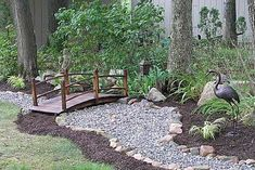 What a terrific idea. This crafty lady made a dry creek bed in her yard, from rocks, gravel and a footbridge she purchased.