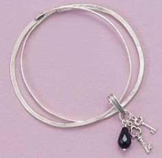 Two Sterling Silver Bangle Bracelets, Key/Black Onyx Bead Charms, 8-1/4 inch around Silver Messages. $109.99