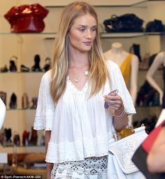 Blonde beauty: Rosie had her long blonde hair down while perusing the store