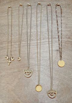 Gold layered necklaces These beautiful boho gold necklaces are designed to perfectly complement each other when styled together, but look equally chic worn solo. 1. Crooss & moon choker necklace of gold filled brass (Gold 24K). 2. Moon choker necklace of gold filled brass (Gold 24K). 3. Gold Necklaces, Round Pendant, Gold Filled Chain, Metal Chain, Chokers, Brass, Unique Jewelry, Handmade Gifts, Etsy
