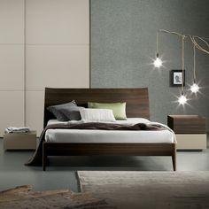 Dark wood bed: minimal, elegant, sturdy.