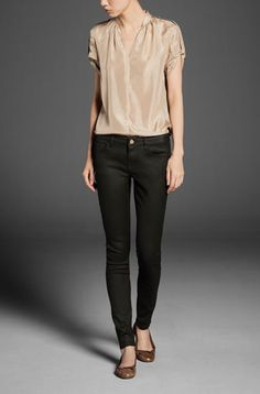 silk sand coloured top with black jeans