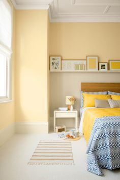 Yellow bedroom painted with Crown matt emulsion in Gentle Yellow