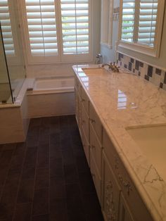 Finished... Carrara marble shower, bath surround, and counter top... Gray slate floor