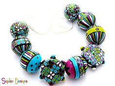 Polymer clay beads by Sigaliot Designs.