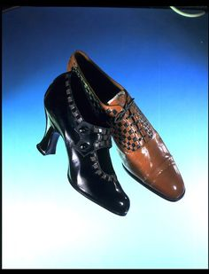 c1925 woman's black shoe, leather with linen lattice work decoration. Fancy man's shoe also shown