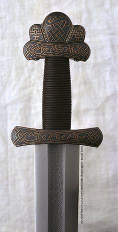 Viking sword hilt from cooper inlay iron, pattern-welded blade. 8th Century. Gjermundbu, Norway.