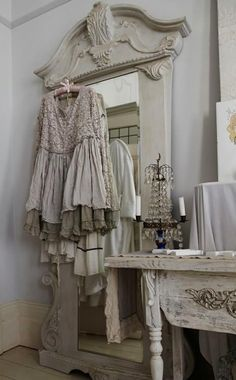 shabby french..love the standing mirror and tabletop chandelier !