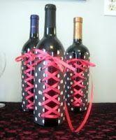 Corset wine bottles. Ribbon and scrapbook paper. Bachelorette party decor idea