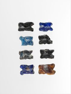 Group of eight glass astragali (knucklebones)    Period:      Imperial  Date:      ca. 1st–2nd century A.D.  Culture:      Roman  Medium:      Glass