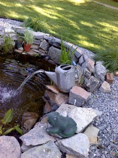 Our fish pond with watering can fountain