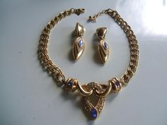 Leritz Design Necklace and Clip on Earrings, £14.99 by Bettabuy Vintage -  A stunning goldtone necklace and clip on earrings with rhinestones and blue glass stones designed by Leritz. The necklace measures approx. 15inches long with a 1 3/4 inch chain extender, the front panel is approx. 2 12 inches wide and 1 1/2 inches deep. The earrings measure approx. 2 1/2 inches long. A lovely quality set in very good pre-owned vintage condition showing little if any wear.