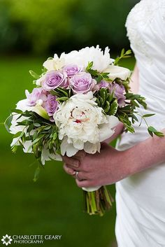 Bridal bouquet with peonies, roses, and calla lilies