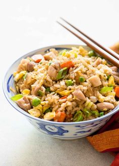 Chicken Fried Rice! This is an easy weeknight meal made on the stovetop. Made with chicken, eggs, onions, carrots, peas, and rice! #Chicken #FriedRice #WeeknightMeal #QuickDinner