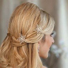 A few snowflakes pinned beautifully into your hair would really complete the Frozen wedding look.