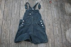 Vintage black denim overall shorts. Super cute for spring! Inside marked 9/10 (see measurements below) made in sri lanka.  Measures approximately:  waist 33 inseam 4 length from waist 15  vintage condition - has subtle signs of use, slight discoloration here and there   ---------------------------------------------------------  Vintage denim jacket, windbreakers, Patagonia and LLBean Fleece Jackets here:  https://www.etsy.com/shop/VintageAmericanWear?section_id=2...